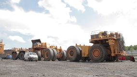 Platform for assembly of dump trucks open pit stock video footage