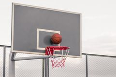 Platform for basketball competitions. A basketball hits the shield and flies into the basket. The concept of winning the game royalty free stock photography