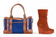 Platform brown shoes and denim handbag Stock Images