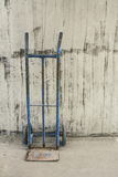 Platform cart and cement Wall Background stock images