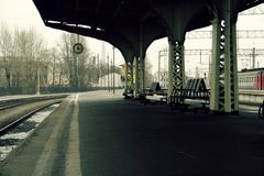 Platform clock and benches without people and no train Stock Photography