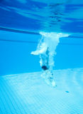 Platform diver under water. In outdoor pool Stock Photo