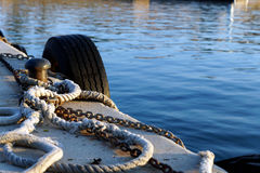 Platform edge with boat ropes. Ropes along a dock in a port mediterranean sea Stock Photo