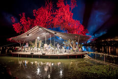Platform floating on water with orchestra at night. Leigo Lake Music festival 2016 Royalty Free Stock Photography
