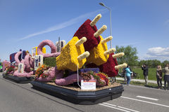 Platform in the form of a plug and cables on Bloemencorso parade. Sassenheim, Netherlands – May 03, 2014: Platform in the form of a plug and cables follows the Stock Image