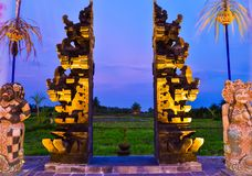 Stone red gate to the rice terrace field during evening sunset royalty free stock photography