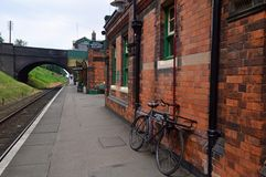 Platform and Old fashioned bicycle at Rothley Station. Belonging to Dormers General Stores. Rothley is a restored Edwardian station on the great central railway royalty free stock images