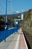 Platform and railway tracks on railway station. Stock Photos