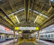 Platform scene at Arashiyama train station, Japan. KYOTO, JAPAN - NOVEMBER 24 : Platform scene of Arashiyama train station with sign and exit in Arashiyama Stock Photos