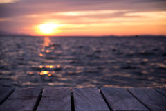 Platform beside sea with sunset Royalty Free Stock Image