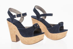 Platform shoes made of cloth blue jean on white background Royalty Free Stock Photography