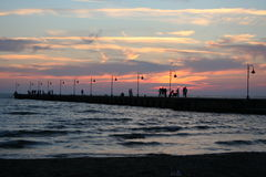 Platform at Sunset. People on the Sea Platform at sunset. Naples, Italy Royalty Free Stock Photos