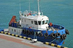Platform supply vessel. PSV in harbor quayside Royalty Free Stock Photography