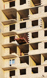 platform for taking heavy load with a crane in the construction multi-storey building apartment. Stock Photography