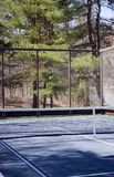 Platform tennis paddle court woods in suburban setting private club royalty free stock photography