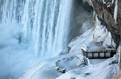 A platform beside Niagara Falls covered in snow royalty free stock image