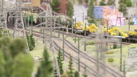 Platform with tractors and fuel tanks. ST. PETERSBURG - JULY 2016: Platform with tractors and fuel tanks in small city, Russia. The Grand Maket, which opened in stock footage