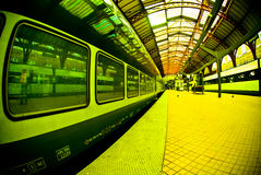 Platform at train station. A view of a train stopped at the platform of the Copenhagen train station Royalty Free Stock Photos