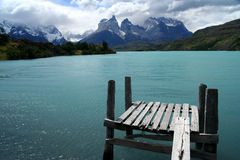 Platform with a view. Wooden platform on a lake with a view of Cuernos del PAine, Patagonia, Chile Royalty Free Stock Photo