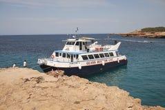 Boat tours in Platges de Comte. Platges de Comte, Ibiza, Balearic islands - August 29, 2014 : Boat tours stop in Platges de Comte Royalty Free Stock Photos