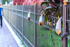 Platic garbage, plastic bag used for sparkling water was left on fence in city Royalty Free Stock Photos