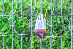Platic garbage, plastic bag used for sparkling water was left on fence in city Stock Images