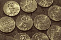 Platina-olhando moedas de um centavo Imagens de Stock