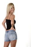 Platinum blonde model in tank tee and jean shorts. Platinum blonde in tank tee and jean shorts royalty free stock images