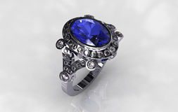 Platinum diamond oval blue sapphire bridal ring Stock Photo