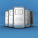 Platinum ingots on blue Stock Photography