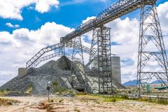 Platinum Mining and Processing of ore, Piles of ore rock being moved and stored. Crushed Platinum rich ore rocks are transported to large piles as small stones Stock Image