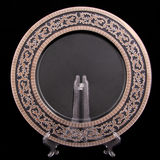Platinum plate. Plate with platinum decorate on black background Stock Photography
