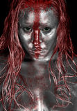 Platinum Red Streak. Ed Streaked Face - Silver Bodypainting with Red Paint stock images