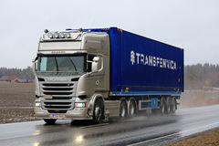 Platinum Scania Semi Trailer on Wet Asphalt Road Stock Photo