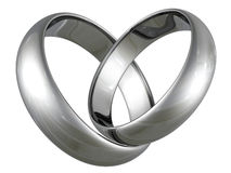 Platinum or silver wedding rings in heart shape. On white background Stock Photography