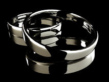 Platinum wedding rings on black background Stock Image