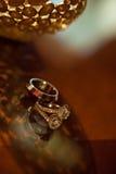 Platinum wedding rings. Creative background. Close up Royalty Free Stock Photography