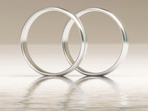 Platinum wedding rings on water Stock Image
