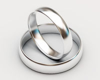 Platinum wedding rings on white background Royalty Free Stock Photography