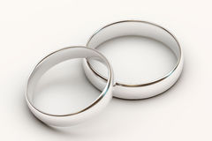 Platinum wedding rings on white background Stock Images