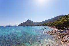Platja de Formentor, Mallorca - AUGUST 2016 - People relaxing at. Platja de Formentor, Mallorca, Spain - AUGUST 2016 - People relaxing at the dreamily beach of Royalty Free Stock Images