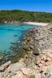 Platja des Bot beach. At Algaiarens cove in sunny day, Menorca island, Spain Royalty Free Stock Images