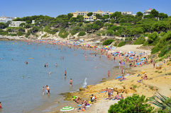 Platja Llarga beach, in Salou, Spain. SALOU, SPAIN - AUGUST 10: Vacationers in Platja Llarga beach on August 10, 2012 in Salou, Spain. Salou is a major Royalty Free Stock Photography