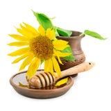 plato con el drizzler de la miel y los girasoles de las flores Imagen de archivo libre de regalías