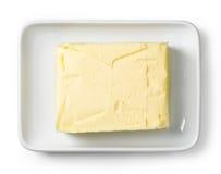 Plato de mantequilla aislado en blanco, desde arriba imagen de archivo