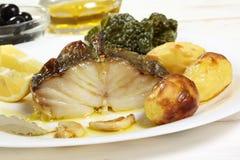 Plato de pescados asado de bacalao Imagen de archivo libre de regalías