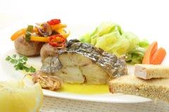 Plato de pescados asado de bacalao aislado Fotos de archivo libres de regalías
