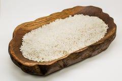 Plato del arroz hecho de la teca Foto de archivo