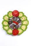 Plato del caracol, del limón amargo, del tomate y de chiles Fotografía de archivo libre de regalías