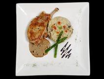 Plato principal: Tajada con la salsa, el arroz y el espárrago Foto de archivo libre de regalías